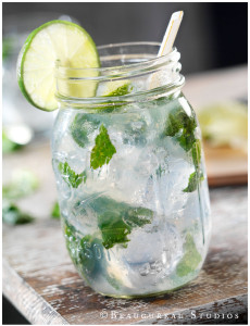 A cool mint mojito, garnished with lime and mint leaves